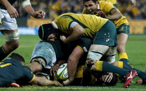 Australian Wallabies Tevita KuriDrani (bottom) scores a try to win the game in the last minute of their Rugby Championship match against South Africa's Springboks in Brisbane, July 18, 2015. Teammate Nick Phipps (top) reacts to the try.   REUTERS/Jason Reed